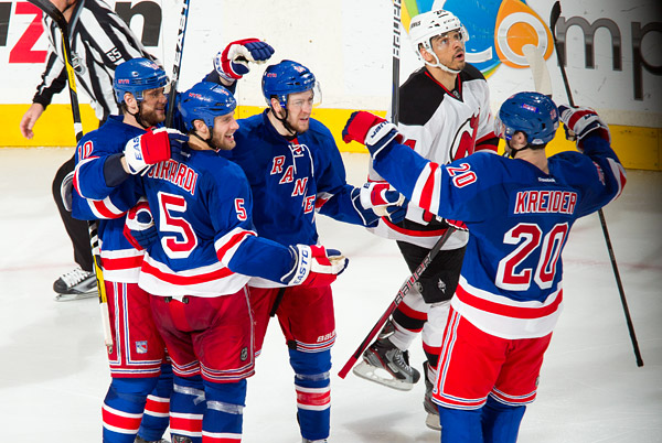 Dan Girardi (#5) celebrates his goal with teammates Marian Gaborik, Derek Stepan and Chris Kreider