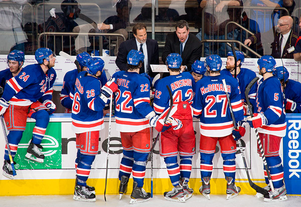 Rangers head coach John Tortorella (left) and assistant coach Mike Sullivan address their team in the game's final minutes