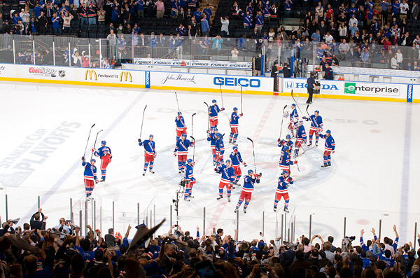 The Rangers salute the crowd from center ice