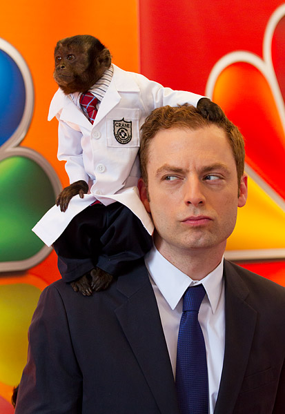 Actor Justin Kirk and Crystal the Monkey on the red carpet at the NBC Upfront at Radio City Music Hall