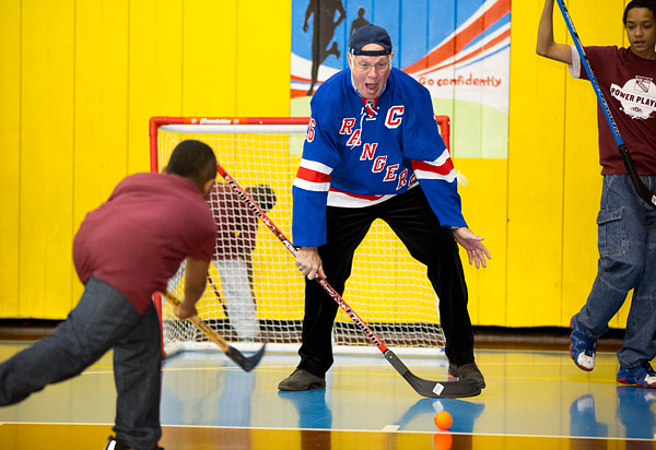 Former New York Rangers captain Dave Maloney conducts a youth floor hockey clinic at a community center in Harlem