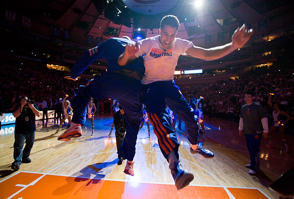 New York Knicks Landry Fields and Tyson Chandler go through their pre-game routine during player introductions
