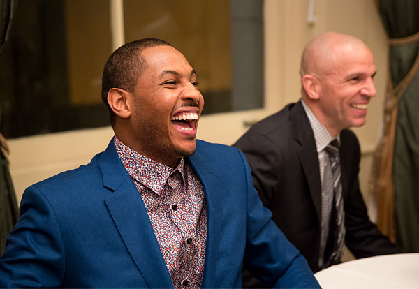 New York Knicks Carmelo Anthony and Jason Kidd share a laugh with teammates in the green room before addressing season ticket holders at a special event in downtown Manhattan