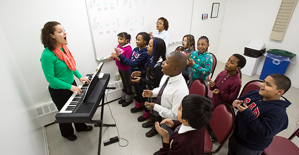 Highbridge Voices Music Director Mary Clementi warms up her class at the program's center in the Bronx