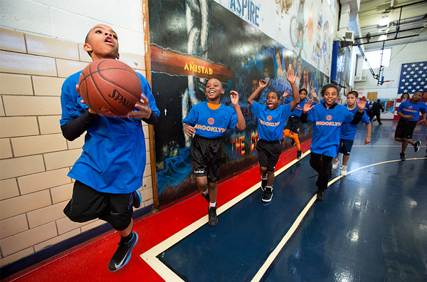 Kids participate in a New York Knicks basketball clinic at Brownsville Recreation Center in Brooklyn