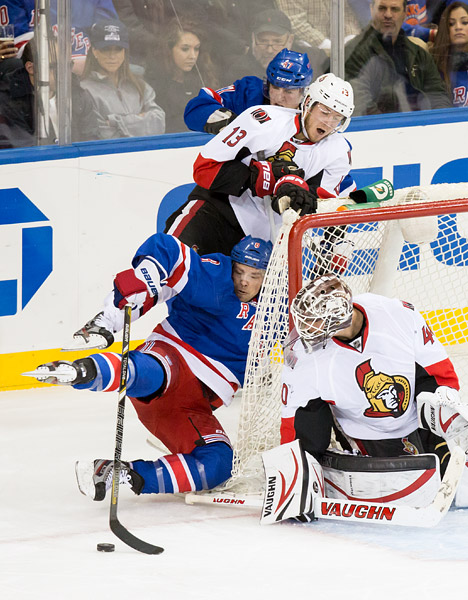 March 8, 2013: New York Ranger Darroll Powe attempts to score on Ottawa Senators goalie Robin Lehner in a 3-2 loss at Madison Square Garden.