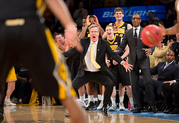 Iowa head coach Fran McCaffery and his team celebrate in the waning seconds of their 71-70 win over Maryland in the National Invitation Tournament (NIT) Semifinals at Madison Square Garden