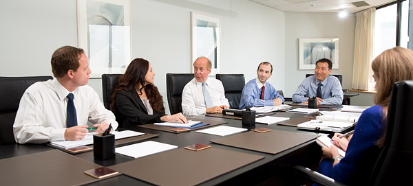 Candid-style corporate portrait of a midtown Manhattan investment firm