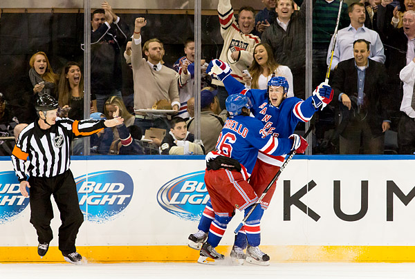 Derek Stepan celebrates his game-winning goal with teammate Mats Zuccarello in the New York Rangers' 5-1 win over the Pittsburgh Penguins.