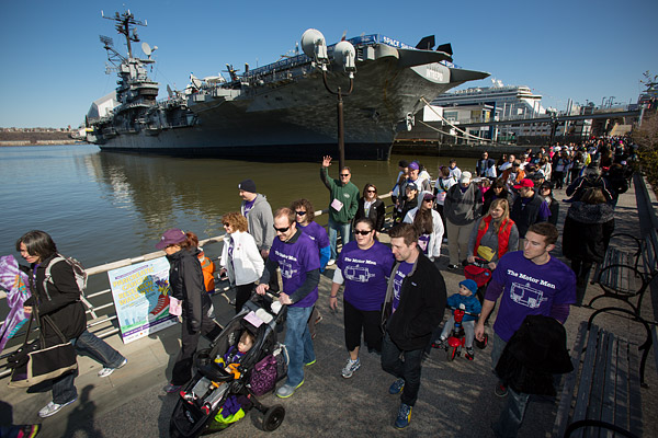 Over 1000 participants walk past the iconic USS Intrepid in the Lustgarten Foundation's Pancreatic Research Walk in New York City