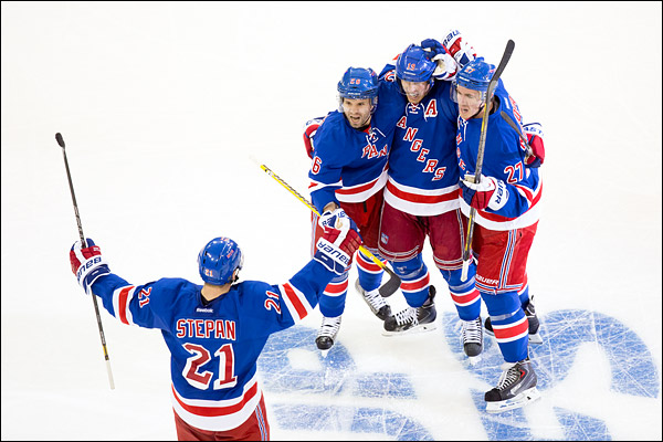Brad Richards celebrates his winning goal with teammates Derek Stepan, Martin St. Louis and Ryan McDonagh in the New York Rangers 4-1 victory over the Philadelphia Flyers in Game 1 of the Stanley Cup Playoffs. Richards tallied a goal and two assists in the game.