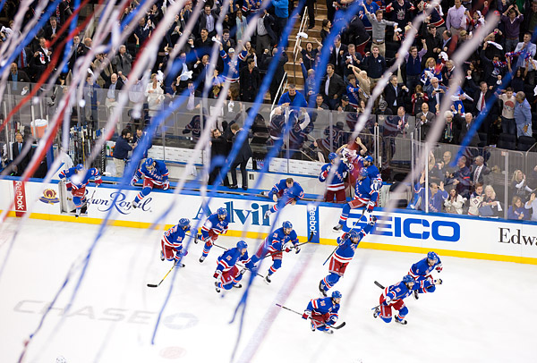 As the final buzzer sounds and streamers fall from the ceiling at Madison Square Garden, the New York Rangers, coaches and fans celebrate their series victory over the Montreal Canadiens, advancing the Rangers to their first Stanley Cup Final in 20 years.