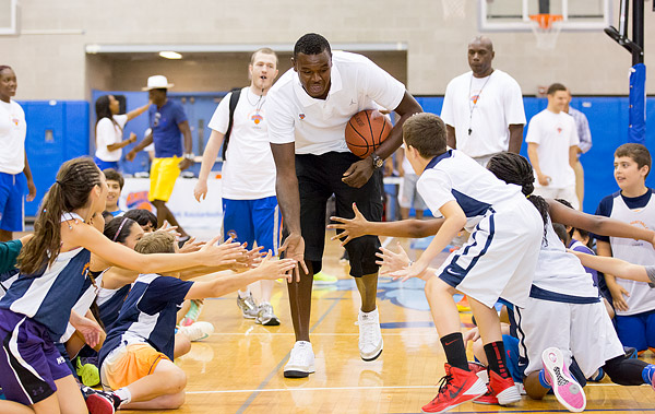 Recently acquired New York Knicks center Samuel Dalembert makes an appearance at Knicks Summer Basketball Camp.