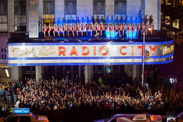 =The Rockettes dance atop the Radio City Music Hall marquee for the season premiere of NBC's America's Got Talent.