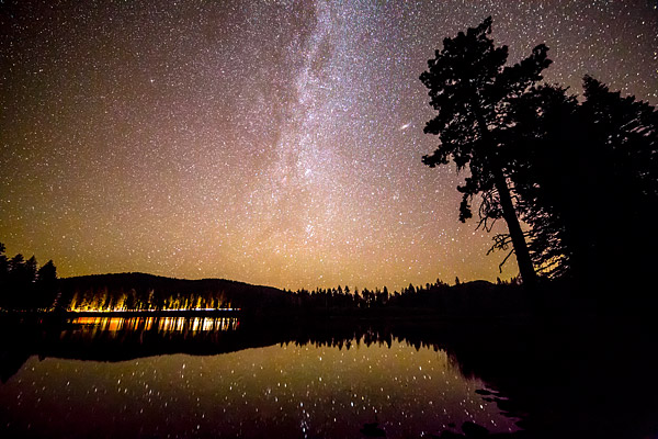 Starry night sky over Manzanita Lake at Lassen Volcanic National Park, California.