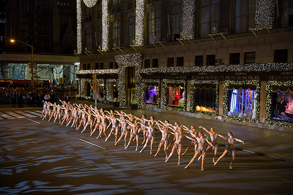 A full line of 36 Rockettes perform in front of Saks Fifth Avenue New York at the store's holiday window unveiling.