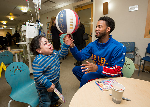 Harlem Globetrotter Anthony Ant Atkinson, with the help of the Garden of Dreams Foundation, spends some one-on-one time with a young patient at a New York City hospital