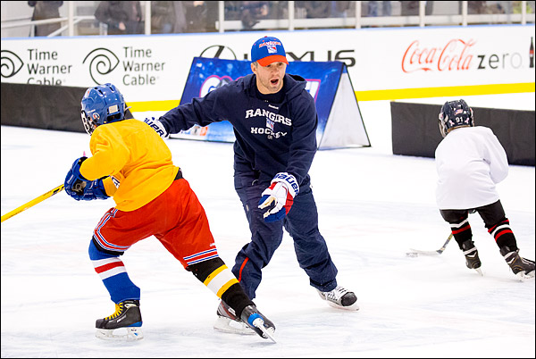 New York Rangers star Martin St. Louis participates in a Rangers Go Skate! youth hockey event